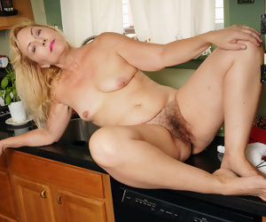 12:27 , American gilf Justine lowers say no to panties in the kitchen