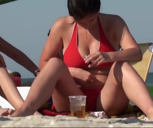 3:38 , Brunette with nice obese boobs on the beach