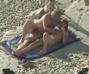 19:16 , Couple Share Hot Moments Atop Nude Beach