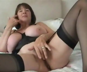 13:14 , Busty Mature in Stockings Performs