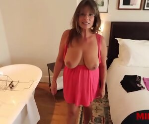 17:25 , Busty mature, Carry Ann doesnt mind displaying her big tits in the sky cam, or..