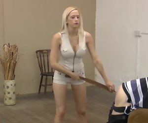 6:02 , hot strict mistress in shorts punishing her concomitant with strap, belt and..