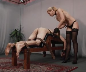 12:43 , Hot derogatory blonde nude mistress caning her slave on caning bench