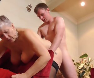 6:15 , Boy having sex with busty British granny